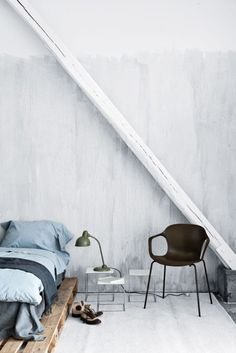 Love the pallets and the concrete. So airy and bright.