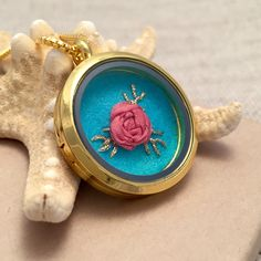 How gorgeous is this one of a kind hand embroidered locket? Great gift for teens, moms, grandmas, teachers and friends. Floral Rose embroidery pendant necklace.         https://www.etsy.com/listing/252807085/embroidered-necklace-embroidery-jewelry