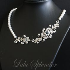 A most classically beautiful wedding pearl necklace that reminds me of a garden party. I have handcrafted the Floral vine feature using lovely