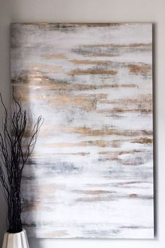 Home Sweet Home - The Chriselle Factor: I also love this texture painting from Z Gallerie. Hanging your paintings high is a great way to add height to a room!