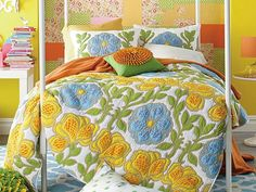 8 Cozy Quilts to Curl Up in This Fall I love the bright colors and the green and gold pillow!