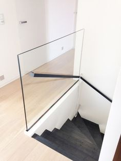 Steel staircase with steel handle and glass parapet (freestanding glass). - Steel staircase with steel handle and glass parapet (freestanding glass).