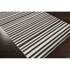 Calvin 1020 Rug, a great choice for any decor that needs a graphic punch in the ever popular black and white combo