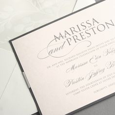 Vera Wang Pewter and Blush Layered Invitation: Wedding cake isn't the only thing you'll want to layer for your big day. Pewter peeks out from underneath blush for this invitation, creating a romantic color palette that pairs well with lovely script and block type. Add a matching response card, which is neatly fastened to the reverse side with a clean, simple band.