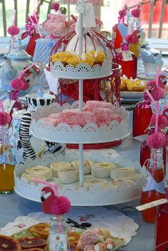 I did it! (73) Another photo of my grand-daughter's Alice in Wonderland party table. Pink flamingo straws, jam tarts, lamingtons, pink bottles with 'Drink Me' labels, rose cupcakes, pinwheel sandwiches, vintage keys, embroidered doilies, painted teapots, all set against an Alice-blue tablecloth.