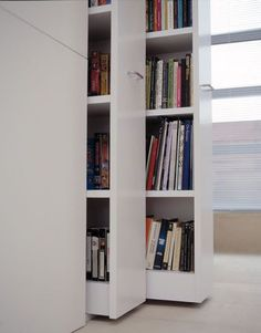 Retractable bookshelves. | Fifty Shades of Grey | In Theaters Valentine's Day Bookshelf Storage, Bookshelves, Bookshelf Decorating, Bookshelf Ideas, Book Storage, Decorating Ideas, Bookshelf Design, Minimalist Interior, Minimalist Home