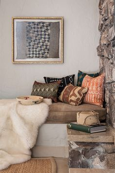 Tribal print pillows, rocks walls, & sheepskin a few of my favorite things!