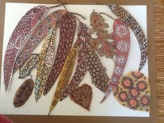 Doodled leaves by Claire: sharpies, distress markers and gelly roll pens on oleander, eucalyptus, red oak & misc. leaves.