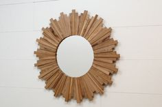 Sunburst mirror 29 x 11/4 made of old White Oak by CarpenterCraig, $380.00.  *FOR ENTRY WALL, but too big for that spot. LOVE THE MIRROR*