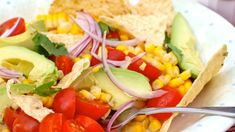 This corn salad with tomato and tortilla is simple, easy to prepare and made with ingredients you probably already have in your pantry.  Corn, known in Spanish as choclo and elote, is one of my favorite ingredients to cook and eat in the summer because it is delicious and versatile. One of my favorite ways of eating it is simply roasting it on the grill with butter and salt, but I also like to prepare Envueltos de Choclo, Arepas de Choclo, soups, salads and much more.  I added cherry…