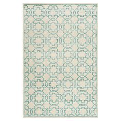Handmade rug with a tile-inspired motif.  Product: RugConstruction Material: WoolColor: Cream an...