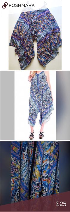 """""""Dark Horse"""" Ilan Jumpsuit All you need this resort season is this Jumpsuit and PTO. The Dark horse Ikat Jumpsuit features ikat print details, a wide leg silhouette, and a V-neck line. Easy pullon design, unlined. Pair with sky high platforms and an amazing vacation. Umgee Dresses Asymmetrical"""