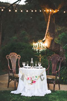 sweetheart table with vintage accessories and chandelier. Photo by Intuitive Images Photography