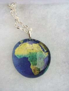 A personal favorite from my Etsy shop https://www.etsy.com/listing/222603481/africa-map-glass-pendant-necklace-with