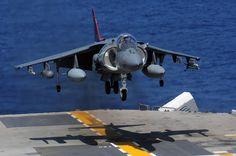 An AV-8B Harrier jet, assigned to Marine Attack Squadron 311, lands on the flight deck of the forward-deployed amphibious assault ship USS Essex (LHD 2).