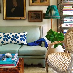 Madeline's blue Fauze suzani pillow in a living room by Ware M. Porter