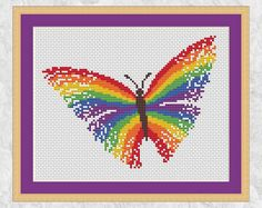 A striking and bright cross stitch pattern of a magical rainbow butterfly. This pattern is also available in shades of pink here: https://www.etsy.com/uk/listing/497374197/ or as a personalised pattern here: https://www.etsy.com/uk/listing/505976947/ • Stitch count: 89 wide x 68 high • Approximate size on 14 count aida: 6.4in wide x 4.9in high (16.2cm wide x 12.3cm high) • 7 colours, DMC numbers given • Uses full cross stitches; no b...