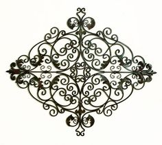 Tuscan Metal Wall Art vatican scrolls handmade iron wall sculpture | products we love