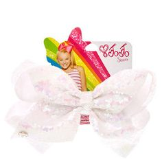 Get JoJo's classic look with this large sequin iridescent white hair bow from the JoJo Siwa collection. The bow has been attached to a metal salon clip making it really easy to wear. Also available in a light gold color and baby pink. Jojo Hair Bows, White Hair Bows, Jojo Bows, Jojo Siwa Hair, Jojo Siwa Bows, Jojo Siwa Birthday, 22nd Birthday, Sister Birthday, Big Bows