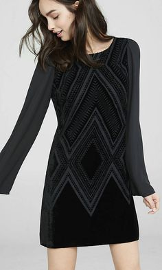 A southwestern-style velvet burnout design gives the front of this dress plenty of texture and style, while semi-sheer chiffon sleeves and a deep v-back add sensual elegance. A knockout with heeled booties and big hoop earrings.