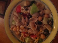 Tried something new it was so amazing, Pasta cucumber tomatoes black olives chick peas cheddar cheese olive oil