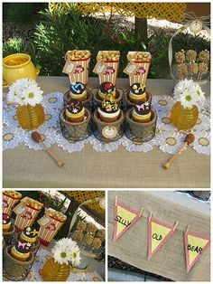I like the burlap tablecloth, daisy table runner, and honey stirrers.