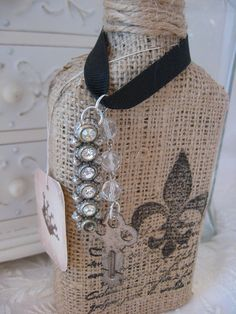 burlap & twine covered bottle, stamped for jewelery display, love the rustic look!