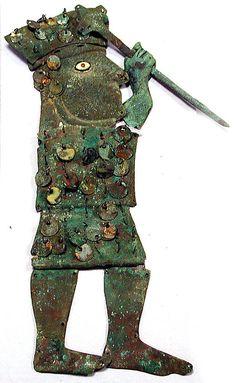 Profile Warrior Ornament Peru,Moche   culture,Loma Negra. 390-450,silvered copper,shell. Metropolitan  Museum
