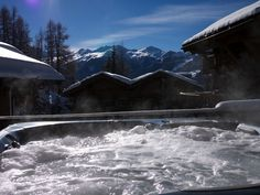 The hot tub on the terrace at Chalet Maurine is the perfect way to relax after a hard ski and to enjoy the stunning views Ski Lift, Ways To Relax, Stunning View, Contemporary Decor, Mountain View, Switzerland, Terrace, Tub, Skiing
