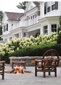 Green and White Gardens, White Hydrangeas, Boxwood's, Fire Pit, White House with Black Shutters