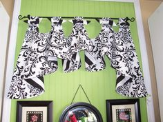 others magnetic tab top valances with black wrought iron curtain rods attached on beadboard wall paneling in lime green paint colors