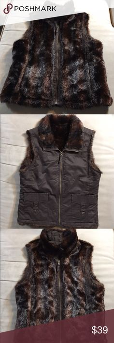 Reversible Faux Mink Fur / Chocolate Canvas Vest This reversible faux mink vest features  gorgeous glossy faux fur on one side, and chocolate brown cotton canvas with faux mink collar on the other.  Super stylish and very real looking!  Wear the fur side dressed up over a cream colored sweater dress.  Or dress down with jeans and boots. GAP Jackets & Coats Vests