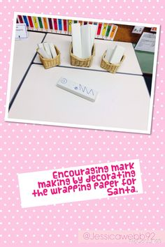 Encouraging mark making by decorating the wrapping paper for Santa.