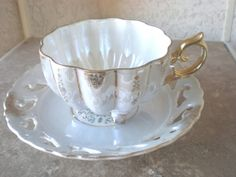 Hey, I found this really awesome Etsy listing at https://www.etsy.com/listing/90153562/tea-cup-three-legged-antique-and-saucer