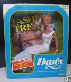Darci doll was a giant compared to Barbie! I had one of these but Barbies clothes did not fit her very well. Loved combing her hair