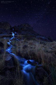 Hail Stars by Tarik AlTurki - beautiful photo of a waterway at night.