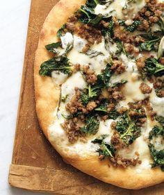 Sausage, Spinach, and Provolone Pizza | Get the recipe for Sausage, Spinach, and Provolone Pizza.
