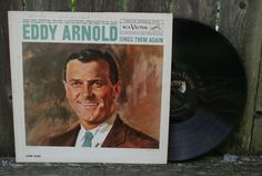 This is a wonderful Album filled with love songs by Eddy Arnold. The front top has the words Mickey- Feb. 14, 1964 written in pen. One can only guess that Mickey gave this album to his sweetheart for Valentines Day. Eddy Arnold Sings Them Again Vinyl Record Album by JoyousVintage, $6.00