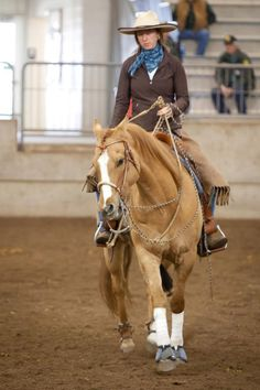 Sibbea with Chase wooing the crowed at NW horse expo in his new 32 plait Vaquero bosal from Buckaroo leather in his 2 rein rig.