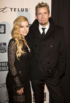 Chad Kroeger and wife, Avril Lavigne, at We Day , in Vancouver, Canada /B.C. on October 18. 2013