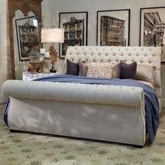 This chic upholstered sleigh bed features a luxurious rolled headboard and footboard and diamond button tufted details. The lovely cream, linen-textured fabric of this platform sleigh bed is accentuated by silver nailhead trim that accents the curve of the footboard. | Houston TX | Gallery Furniture |
