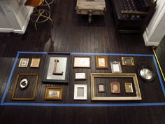 how to practice a gallery wall layout! + newspapers cut into same sizes & attached to wall.