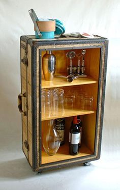 Add birch paneling, shelves, and wheels to an old trunk to create a truly unique rolling bar cart.
