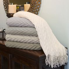 Charisma® Metro Throw - A layer of luxury from Charisma®. Patterned with dimensional chevron stripes for striking texture, the fringed Metro throw is wonderfully soft and silky to the touch.