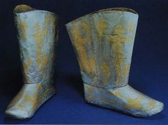 Gold and Silver Wares in the Liao Dynasty. Silver boots with gilt phoenix design.