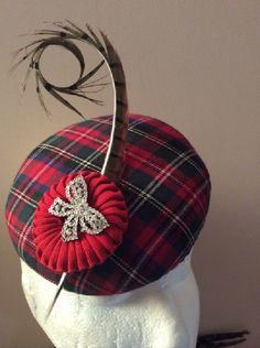 Small tartan button with curled pheasant feather, petersham cockade and diamonte bow