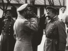 Emperor Nicholas II and Grand Duchess Olga Alexandrovna (smiling!) of Russia