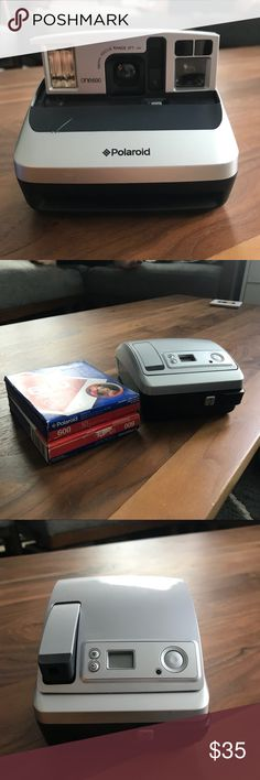 Polaroid Camera Polaroid camera with two packages of film. I haven't used it in over a year but it worked the last time I used it. It has a scratch on the front but lens is fine. Polaroid Other