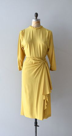 1940s mustard yellow rayon dress with trapunto collar, ruched shoulders, 3/4 sleeve, gorgeous hip drape and metal side zipper.