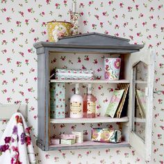 Vintage bathroom unit and floral wallpaper It's all about the packaging with these gorgeous toiletries, so show them off with an open shelving unit mounted on the wall. Top marks for the vintage wallpaper and hand towel too. Similar cabinet  Fade Interiors  Read more at http://www.housetohome.co.uk/room-idea/picture/vintage-bathroom-ideas-10-of-the-best/5#kXk0gSHCriMGWyiO.99